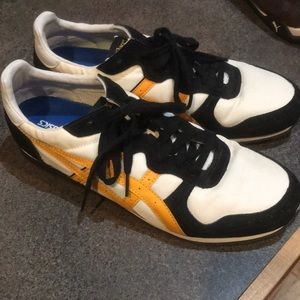 ASICS yellow, black and white sneakers